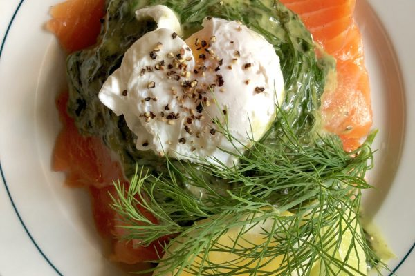 Smørrebrød of house gravlax, creamed spinach, poached egg, on white sourdough toast, at Schønnemann