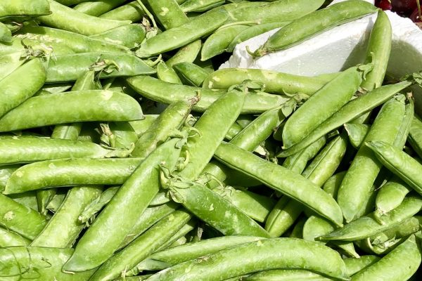 Spring peas in the pod, at a street market